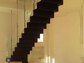 TRESCALINI - wave : escalier quart tournant acier et verre - Escalier Suspendu
