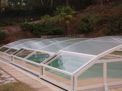 Abrideal - Abri de piscine bas coulissant ou télescopique-Abrideal-NEO