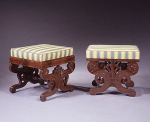 CARSWELL RUSH BERLIN - assembled pair of carved mahogany upholstered foot - Footstool